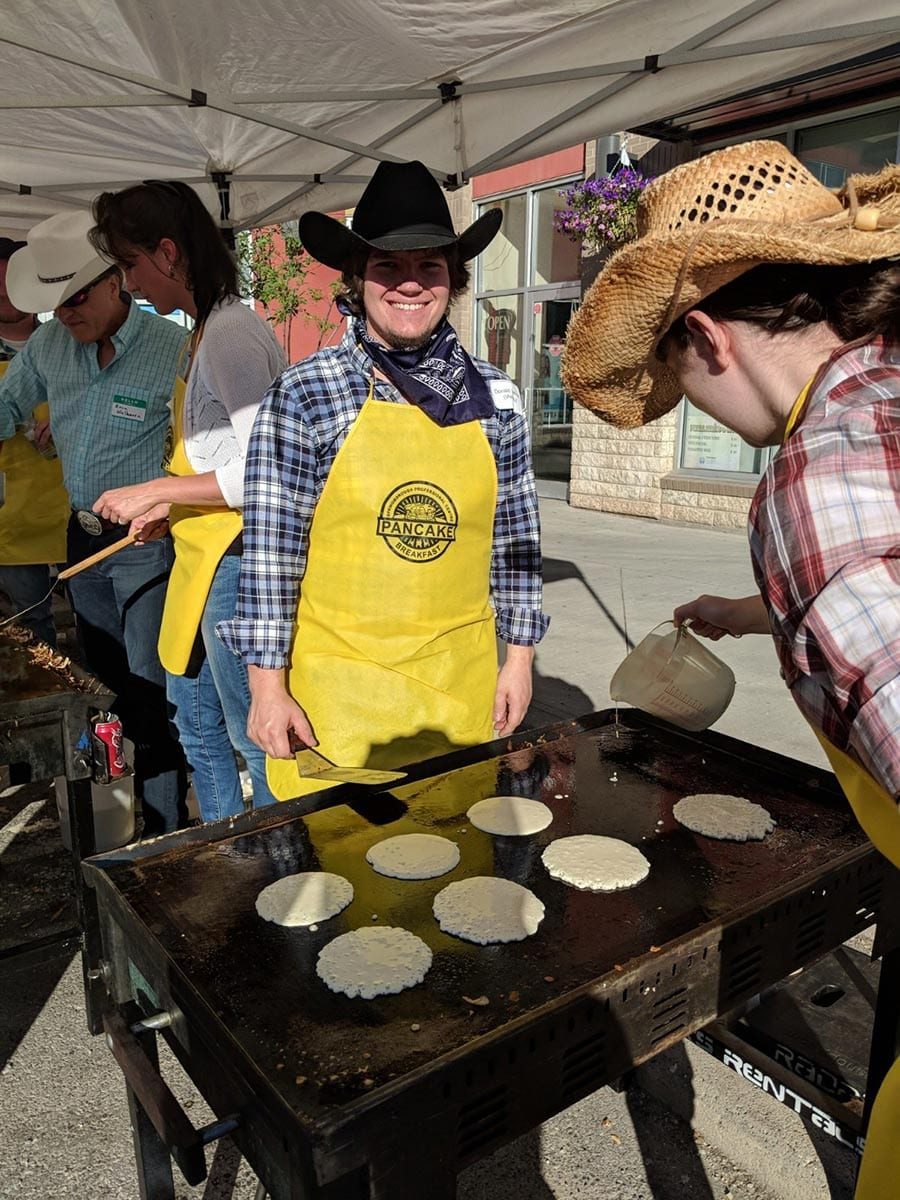 Flippin' some flapjacks at the Stampede Breakfast